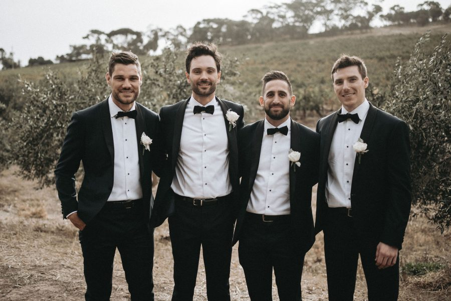 Group of men wearing DELUCA custom tailored suits in Adelaide