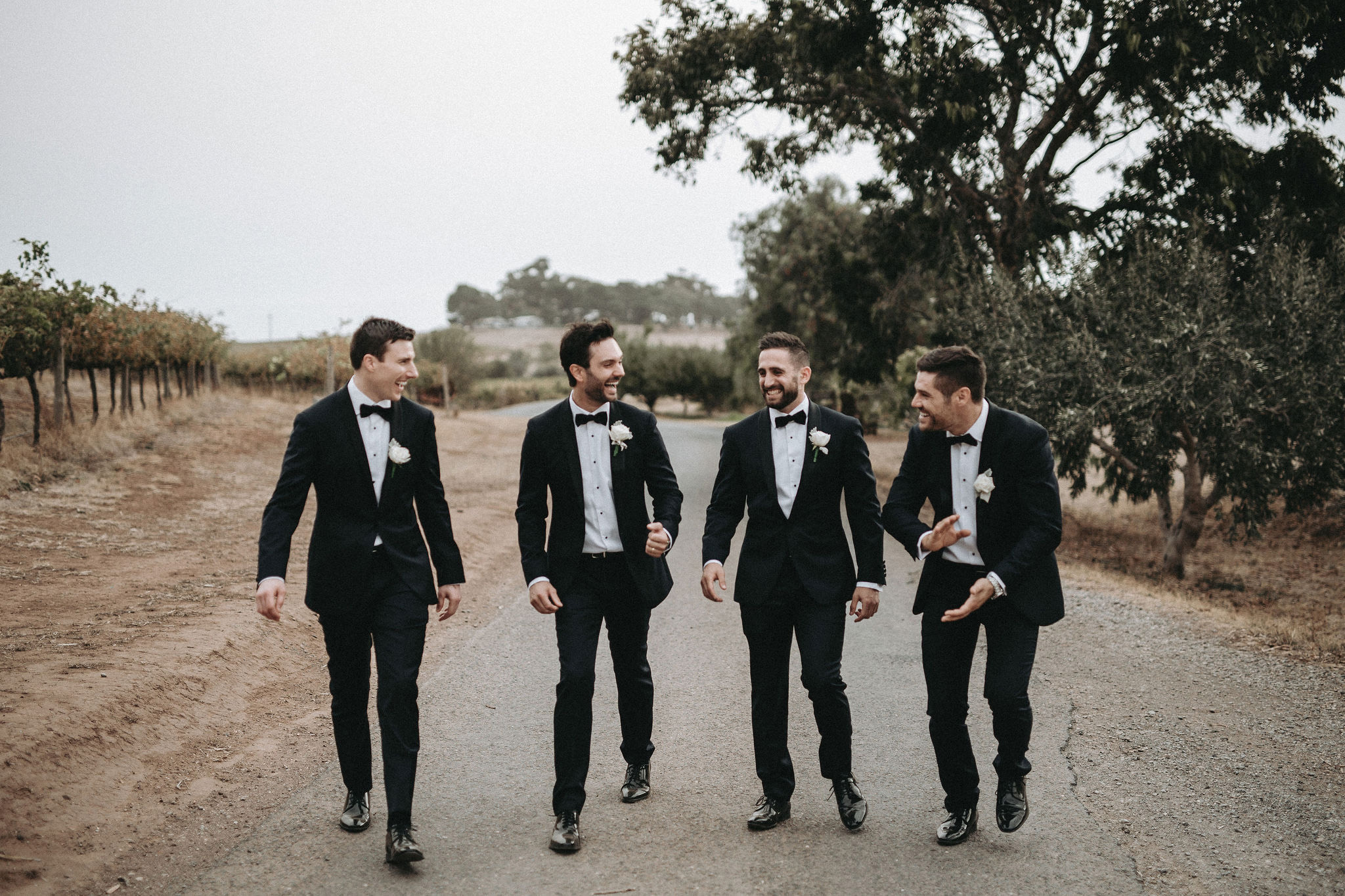 Groom and groomsmen wearing matching custom tailored suits