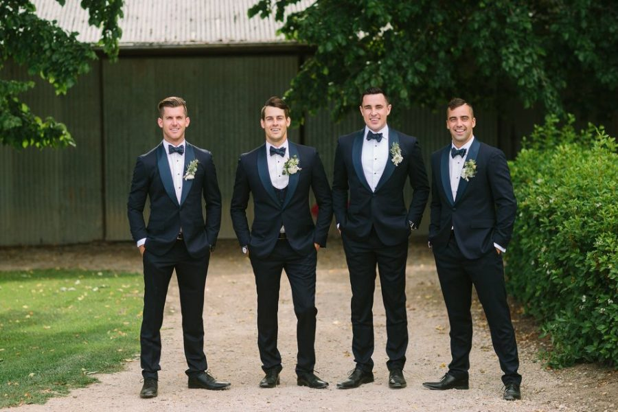 Groomsmen in Adelaide wearing DELUCA wedding suits